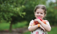 A girl holds some apples at Apple Jack Orchards