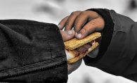 Two hands hold a smore.