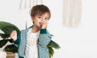A child models organic clothes from online boutique Lulie Kids.
