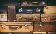 stack of vintage hard-sided luggage
