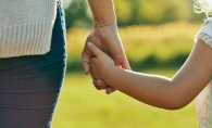 A child holds their parent's hand at Sensory Friendly Sundays at French Regional Park.