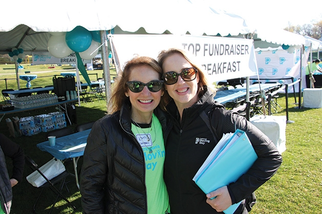 Two women pose for a photo at the Parkinson's Foundation's Moving Day.