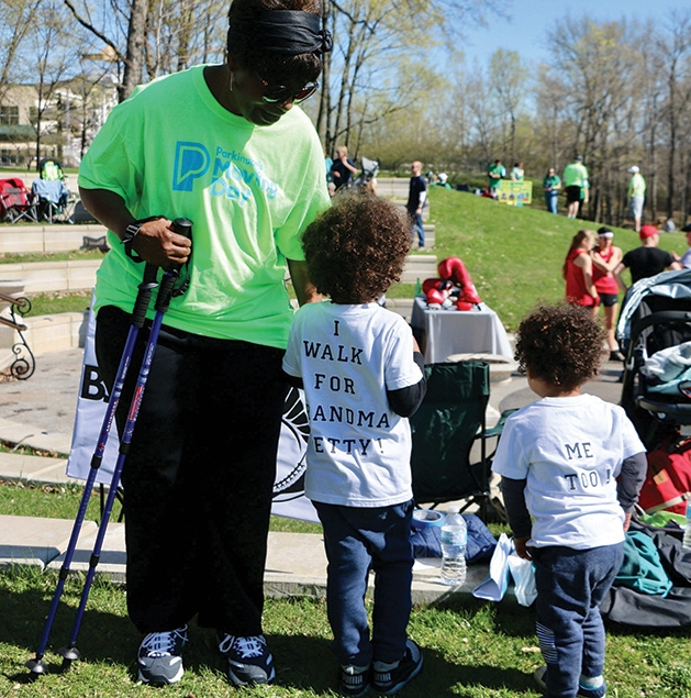Two children walk with their grandmother at the Parkinson's Foundation's Moving Day.