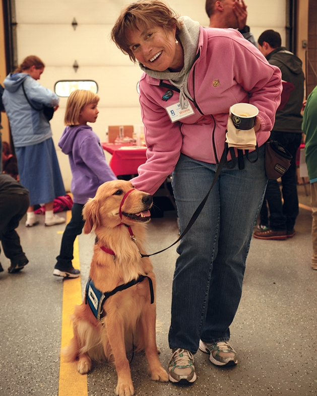 Mary Tiegan with Winnie of Helping Paws