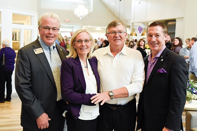 Plymouth city council member Ned Carroll, Karen and Jerry Parks, Mayor Jeff Wosje at the Parks' Place Grand Opening