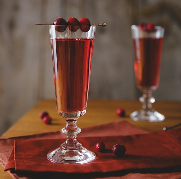 A winter cocktail featuring sparkling wine and cranberry liqueur.