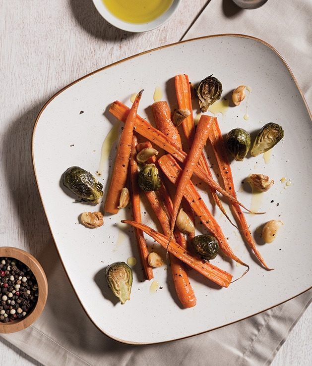 Roasted carrots and brussels sprouts, a Thanksgiving side dish recipe by advisory board member Stuart J. Adelman.