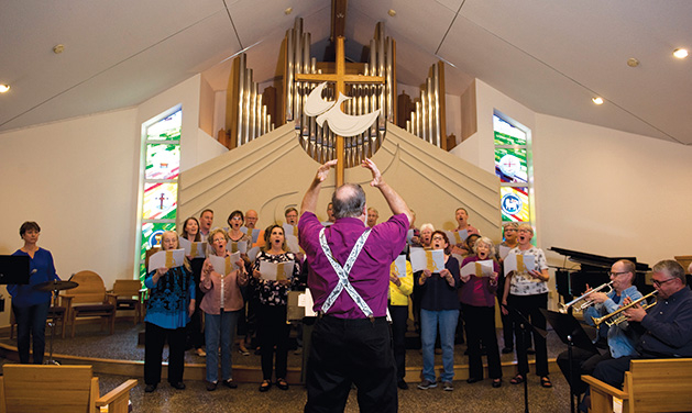 The congregation at St. Barnabas Center for the Arts sings.