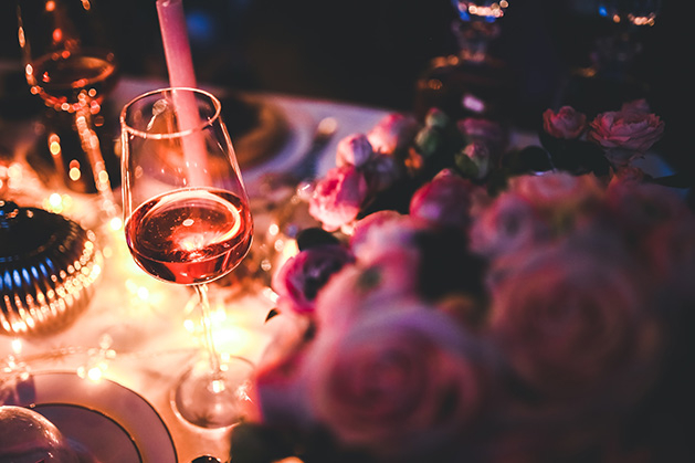 Romantic date night, wine, flowers, candles