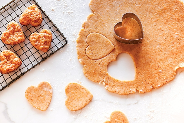 Heart-shaped cookies cut out of a piece of dough