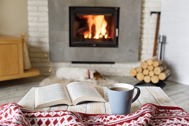 Feeling hygge in front of a fireplace