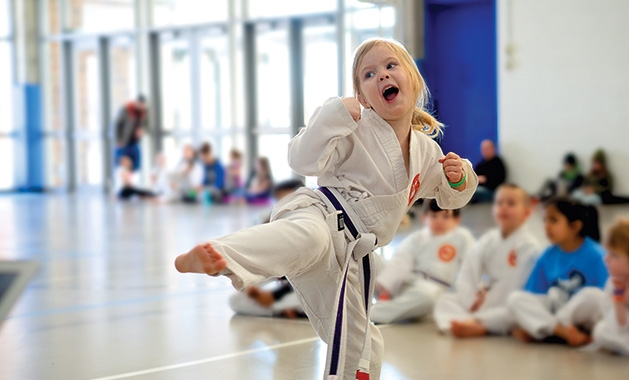 Bellatrix Shamblin performs a kick at Plymouth National Karate School