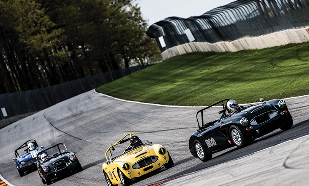 Racers drive classic cars at Road America.