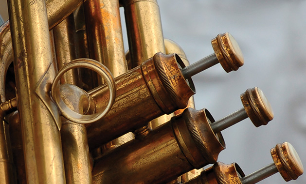 A close-up shot of the pistons of a trumpet.
