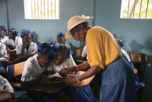 A representative of Days for Girls teaches Haitian girls about menstrual hygiene products.