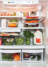 A fridge full of organized groceries
