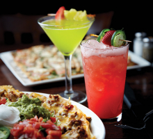 Two cocktails and a plate of nachos from the Sunshine Factory, voted Best Restaurant, Best Tavern and Best Patio Dining in the 2019 Best of Plymouth readers' survey.