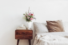 Bouquet of flowers on bedside nightstand