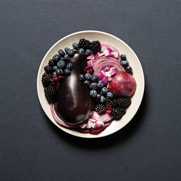 A variety of healthy, purple foods like eggplant, onions, blackberries and more.